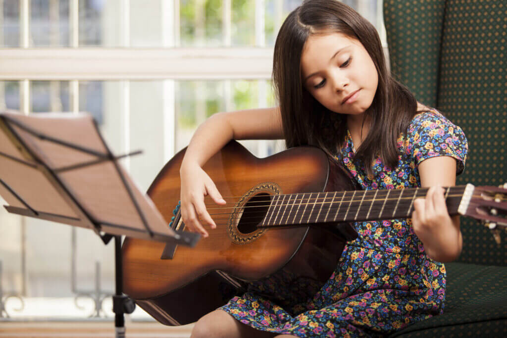 Little girl practices her music lesson at home in North York